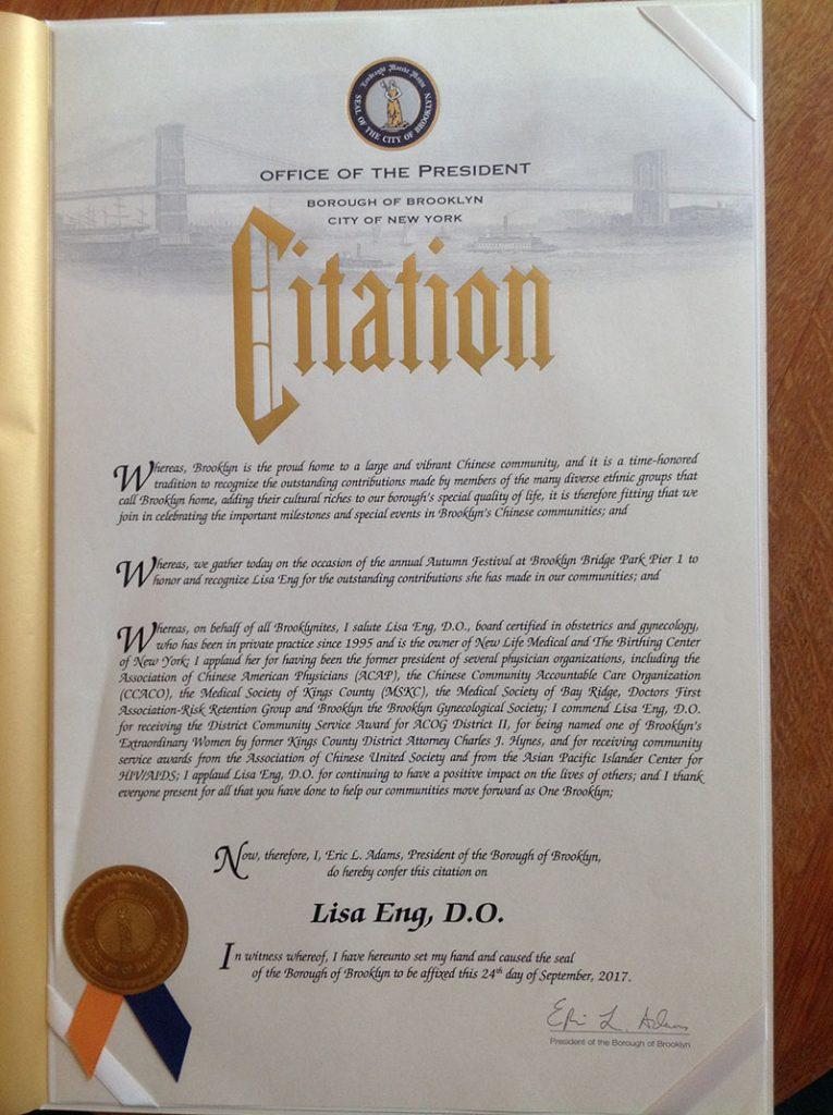 Dr. Lisa Eng receives citation from Borough President Eric Adams