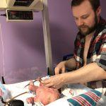 Daddy cutting baby Noahs cord